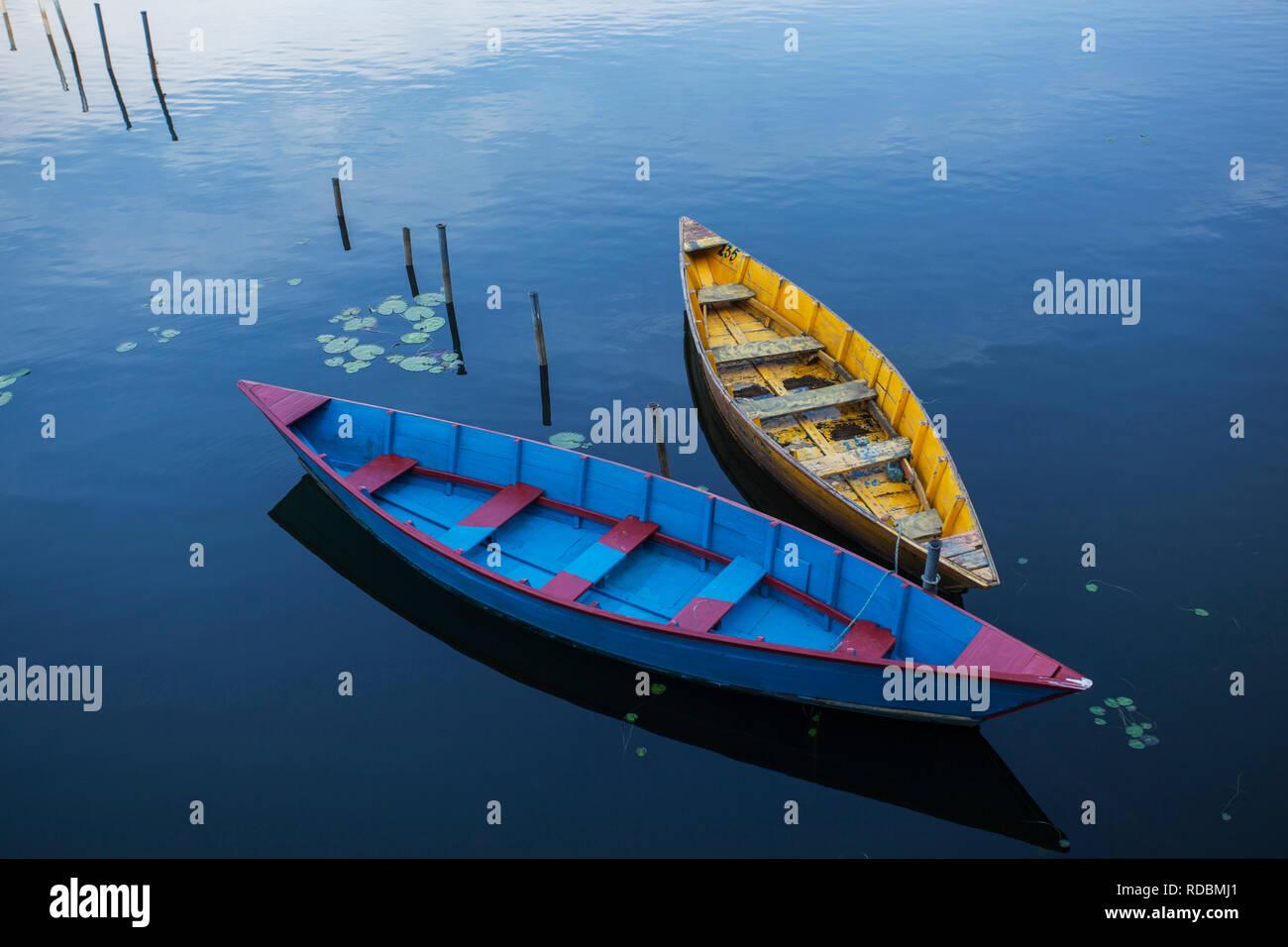 Boats in Begnas lake in Pokhara, Nepal. - Stock Image