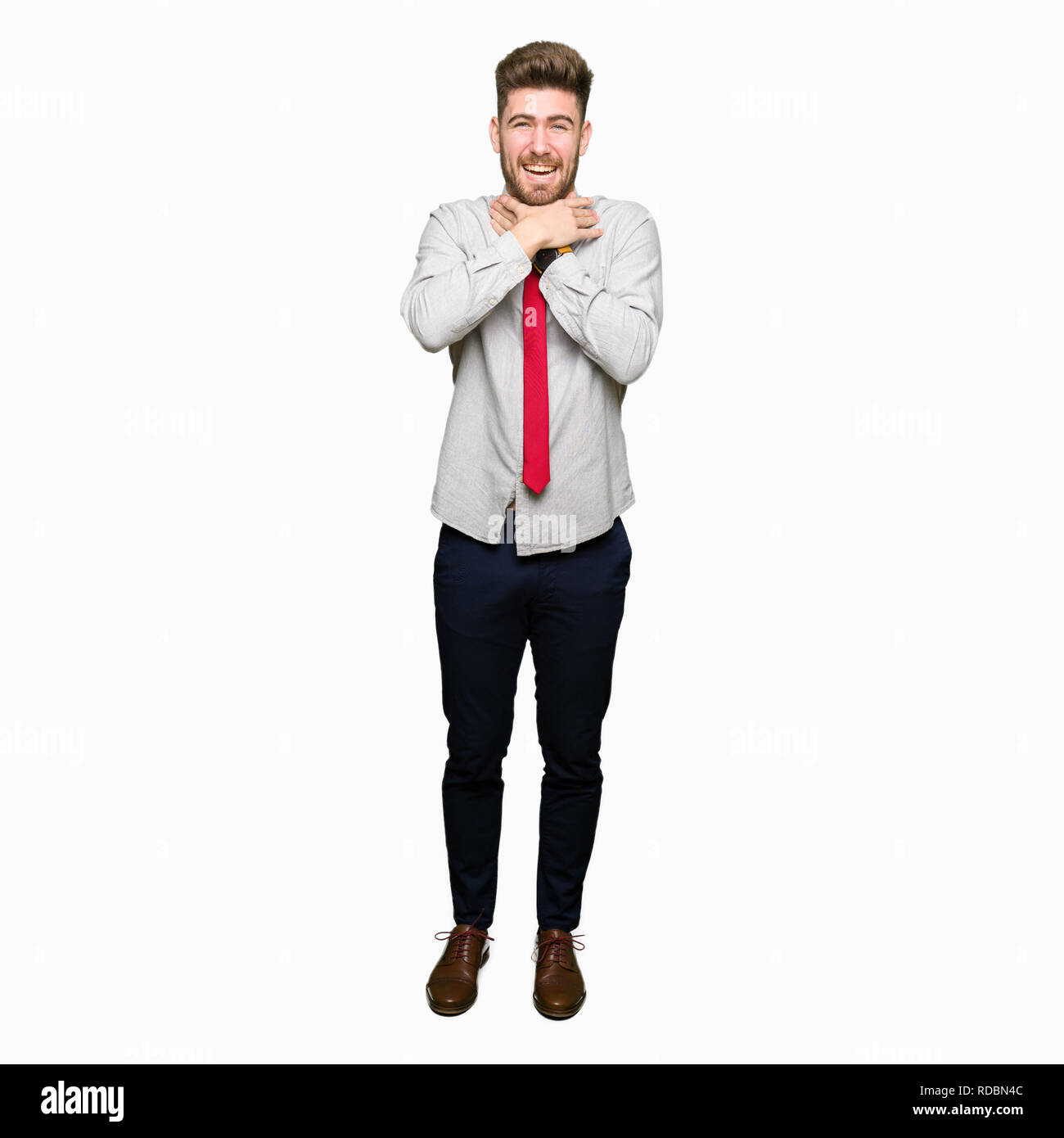 Young handsome business man shouting and suffocate because painful strangle. Health problem. Asphyxiate and suicide concept. - Stock Image