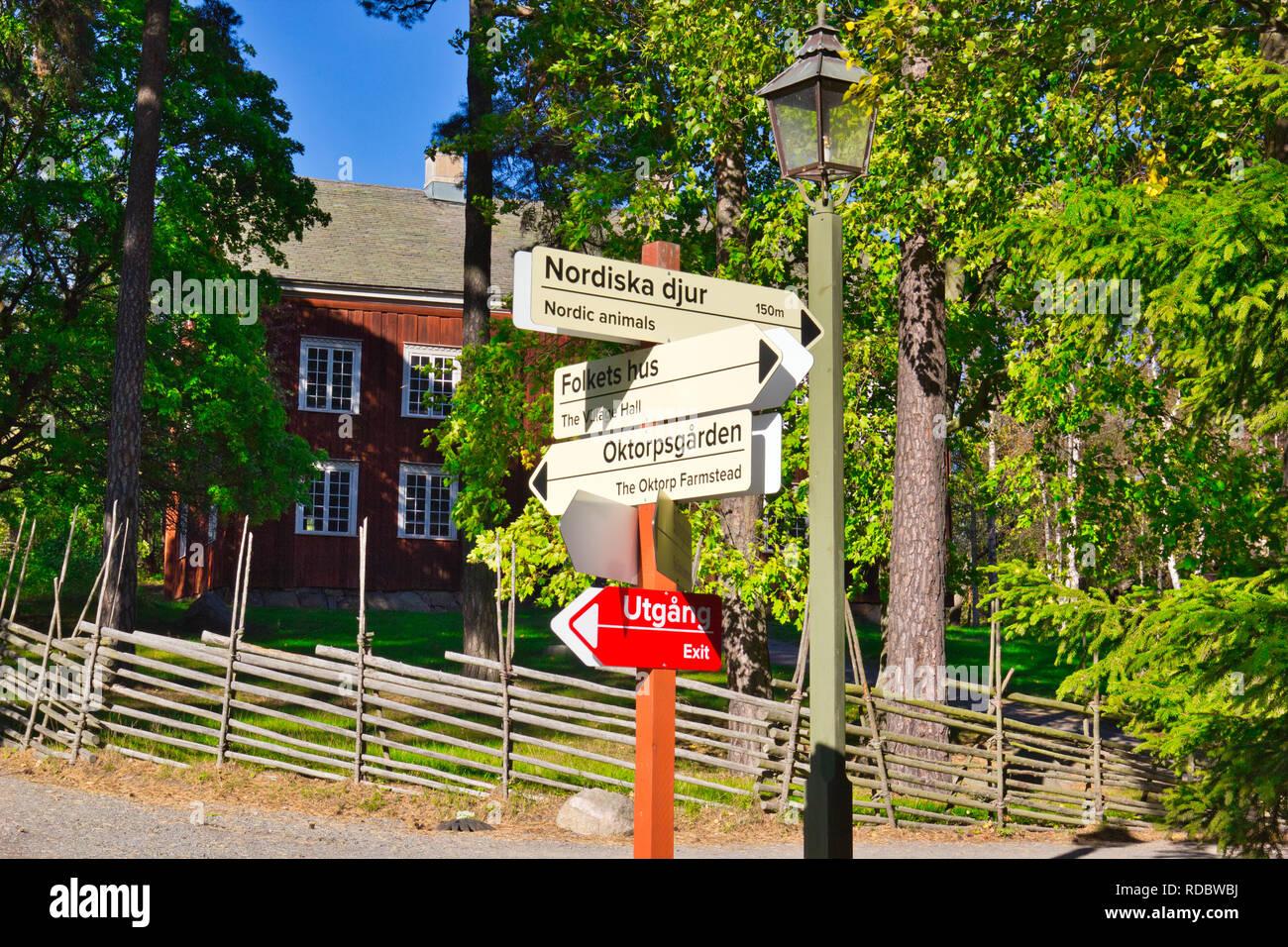 Tourist information and direction signs outside Eksharad Farm manor house, Skansen, Djurgarden, Stockholm, Sweden, Scandinavia - Stock Image