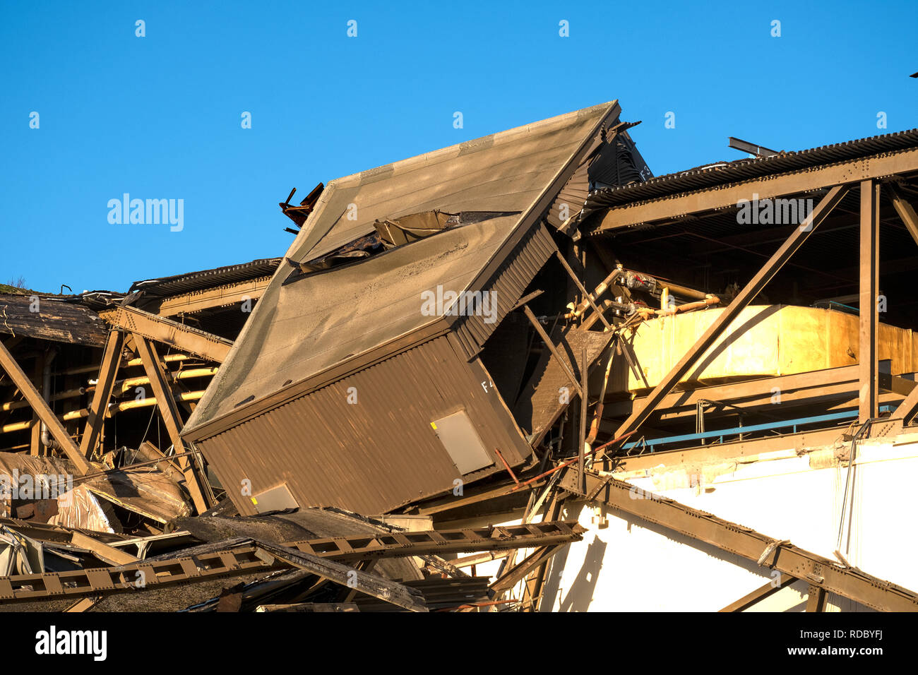 Collapsed factory roof demolition background - Stock Image