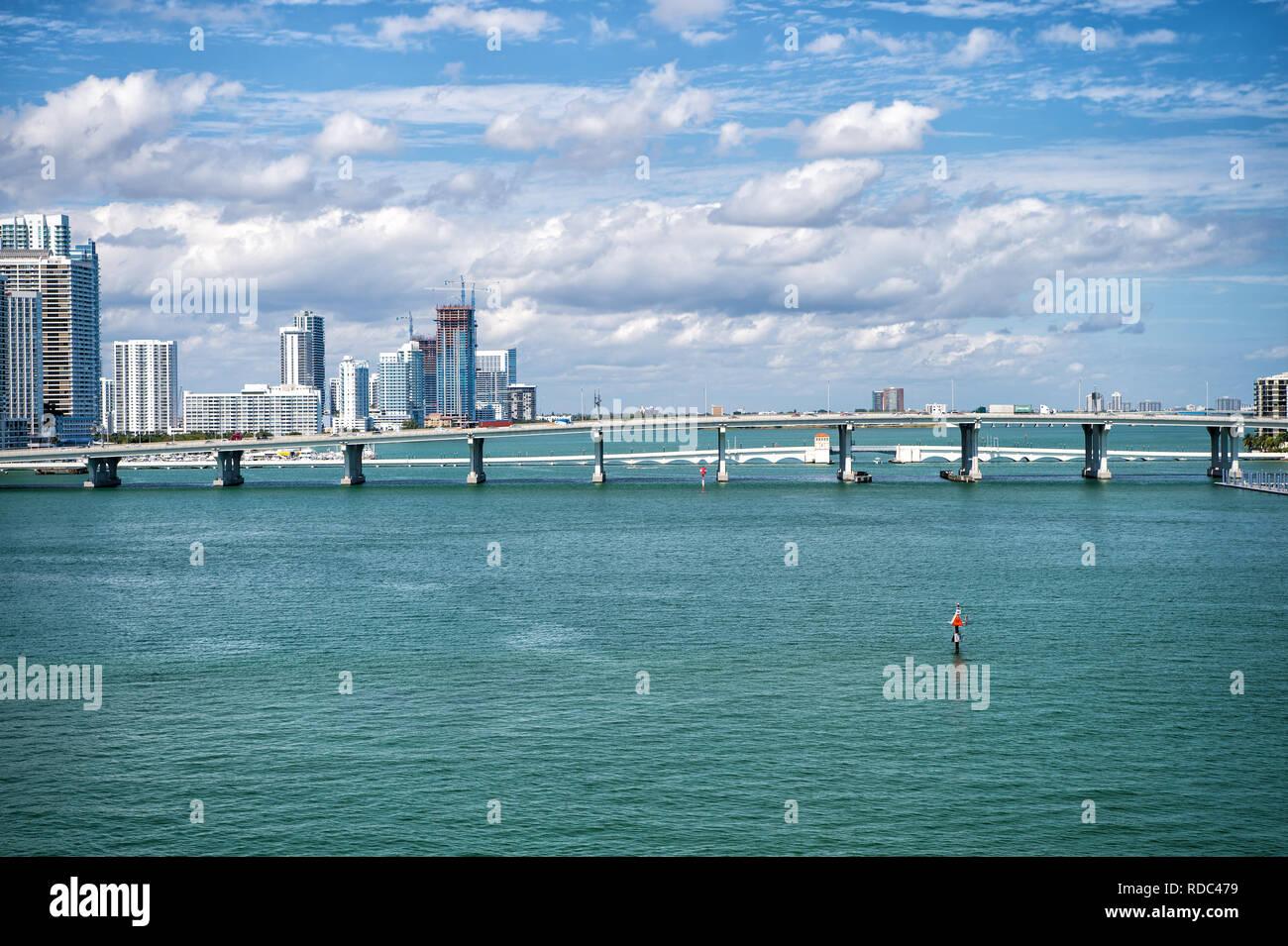 Miami, USA - 29 FEB 2016: Bridge over the Atlantic ocean in the middle of the sea. miami skyscrapers in coastline of usa with Venetian Causeway crosses Biscayne Bay. travel to usa, miami - Stock Image