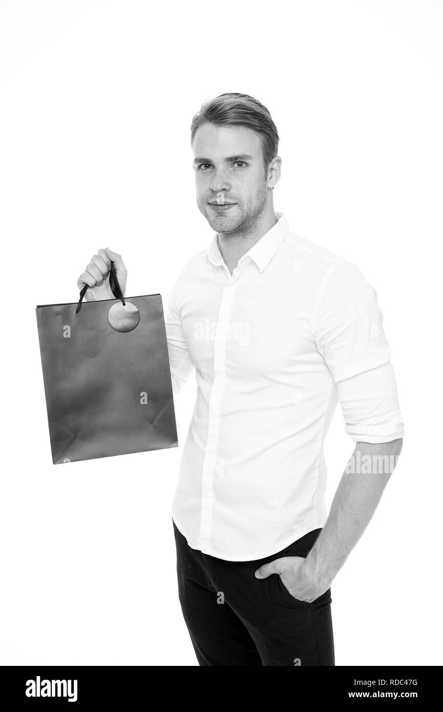 Shop with list. People overspend or buy things they not want, not need because they have not prepared properly. Man carry shopping bag. Guy shopped with list bought exactly what he needs. - Stock Image