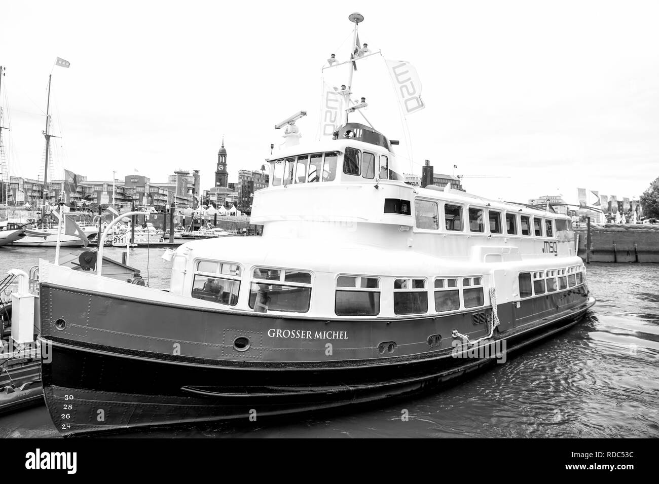 Hamburg, Germany - September 07, 2017: boat or ship at pier in Elbe river port in city. River transport, transportation. Water travel travelling, trip. Vacation discover, wanderlust. - Stock Image
