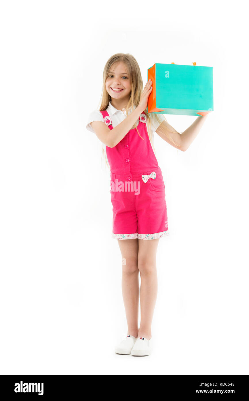 Smart ways to save on clothing. Girl cute teenager carries shopping bag. Kid bought clothing sale. Loyalty program helps save money. Loyalty programs extremely popular with savings. Shopping savings. - Stock Image