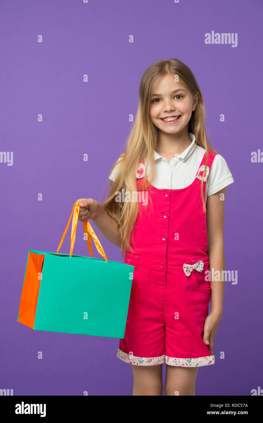 b60da8bf309 Summer sale. Girl cute teenager carries shopping bag. Kid bought clothing summer  sale. Sale benefits. Seasonal sale concept. Girls absolutely fond of ...