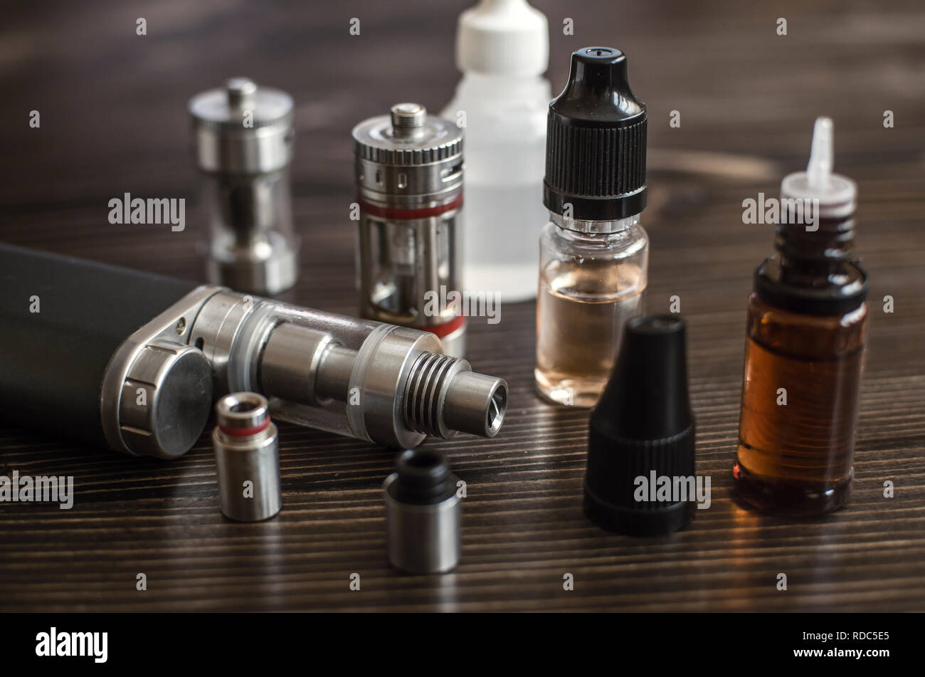 Kit for healthy smoking on wooden background, e-cigarette - Stock Image
