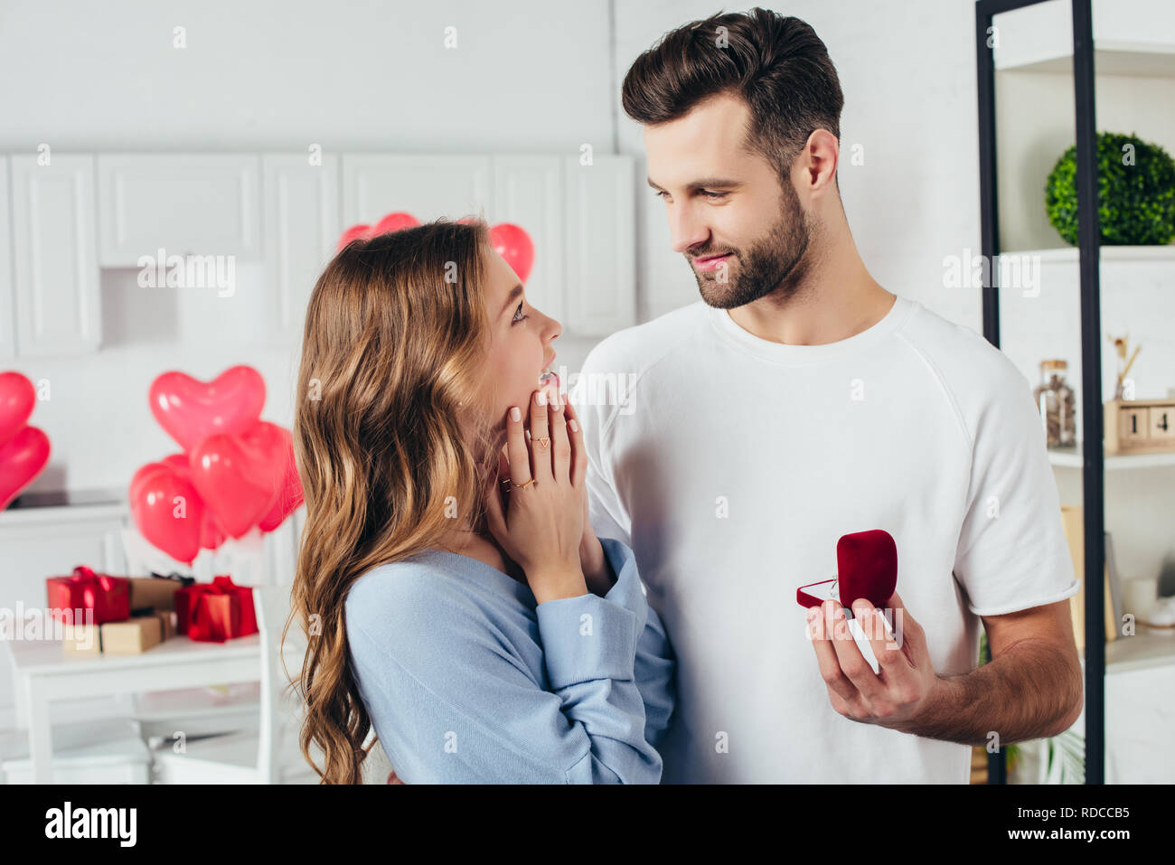 selective focus of man doing proposal at valentines day to girlfriend Stock Photo