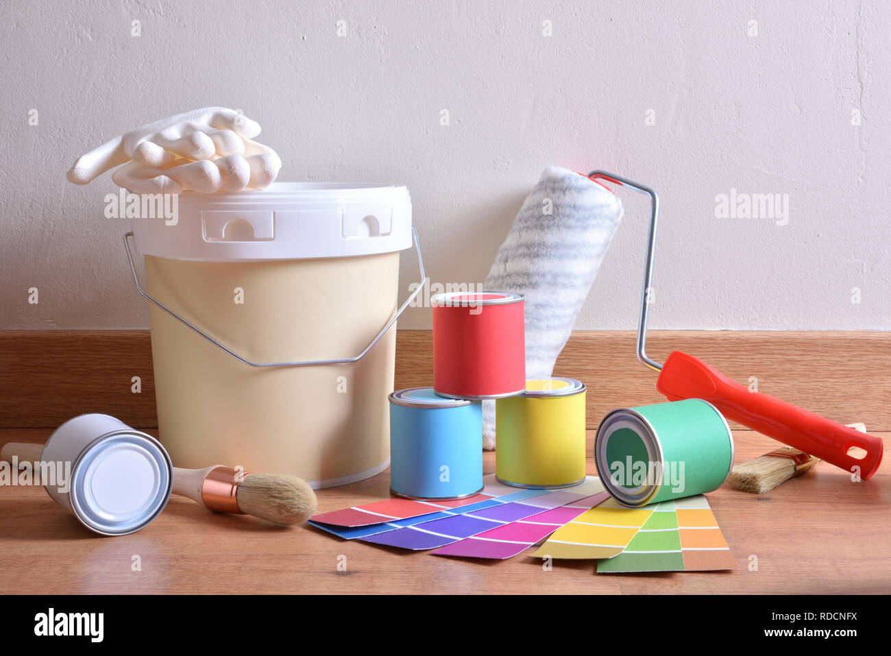 Painting Tools For Home On Parquet With White Wall Background