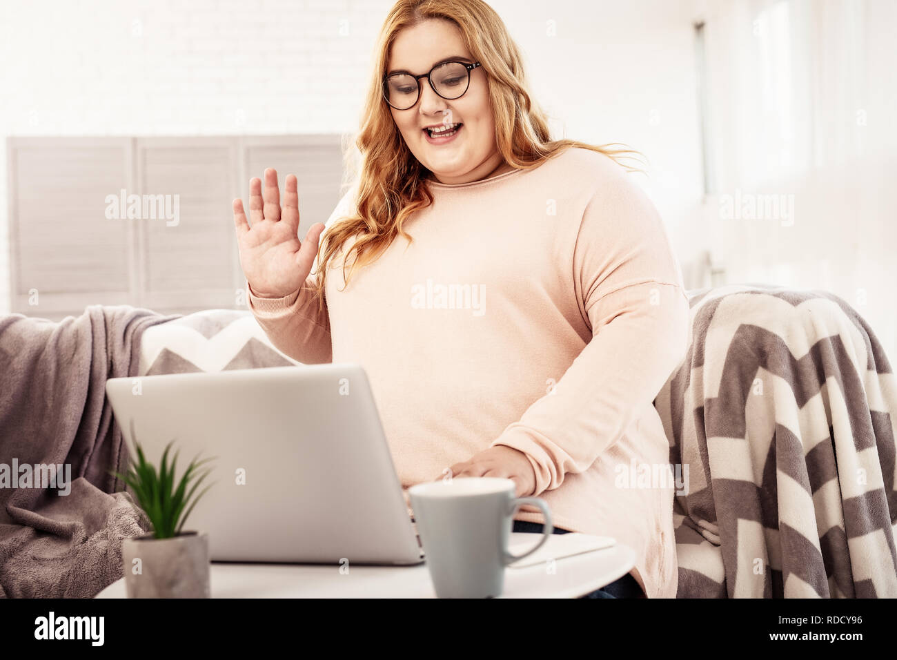 Resolute contented overweight woman with glasses on - Stock Image