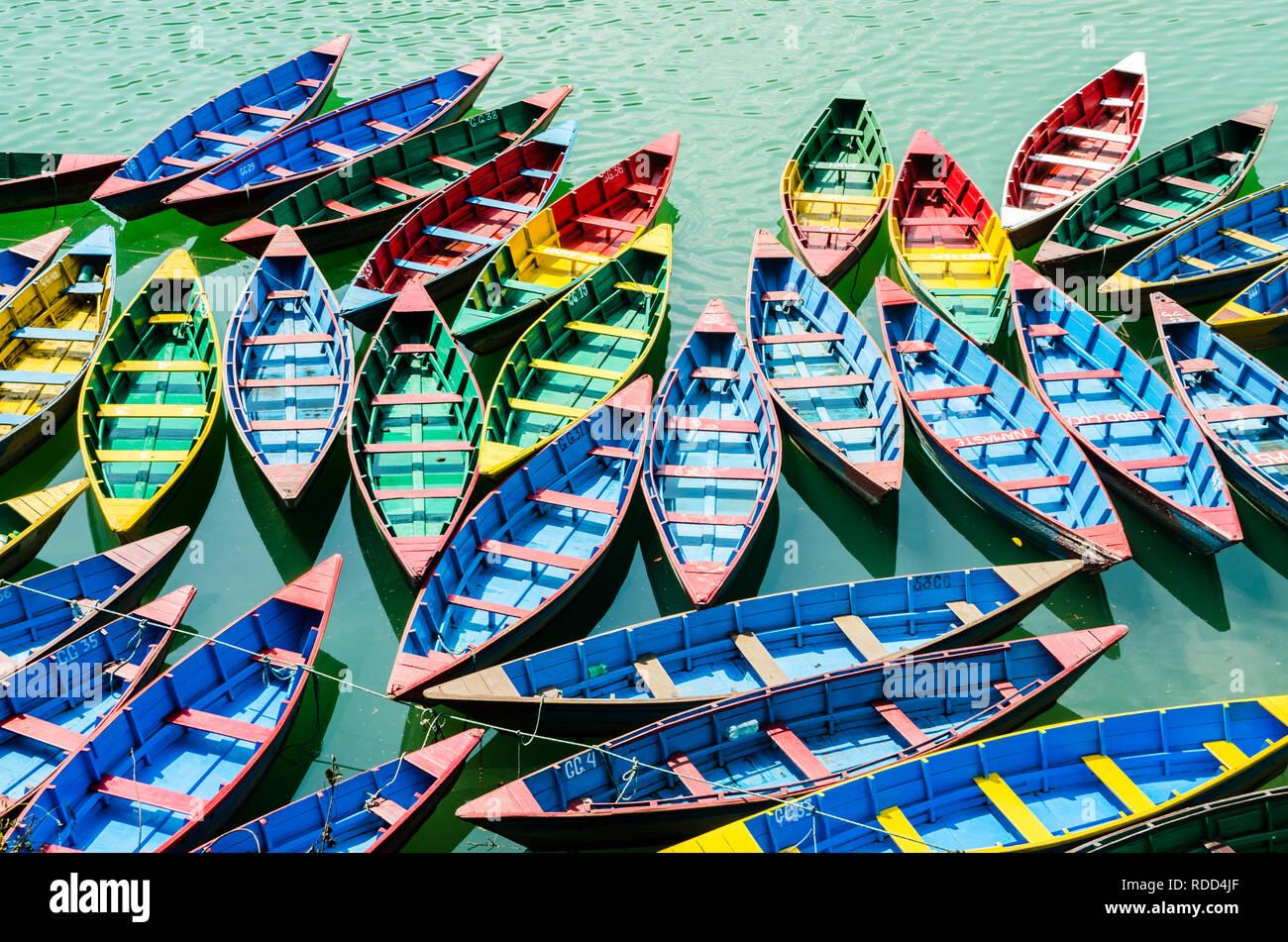 Colorful wooden boats in Phewa Lake, Pokhara, Nepal - Stock Image