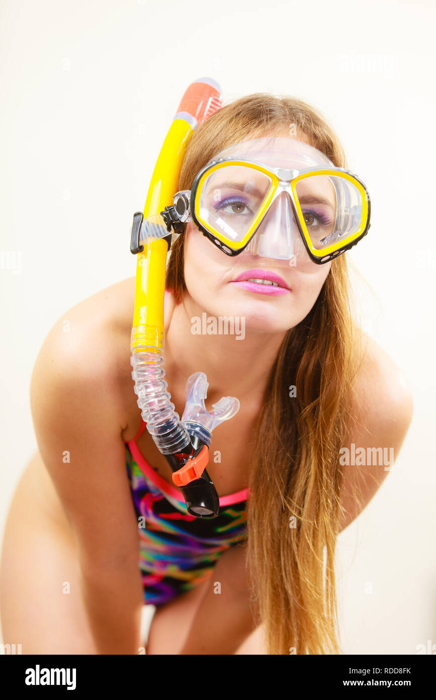 5c307dd526 Woman wearing swimsuit with snorkeling mask having fun studio shot, Happy  joyful girl dreaming about active summer vacation. Snorkeling swimming conce