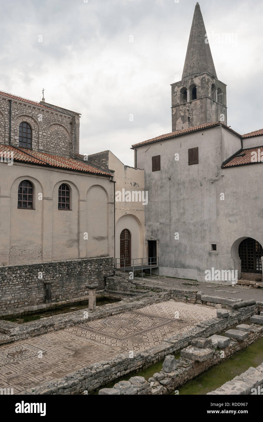 View of the bell tower and fourth century floor mosaics displayed at the Episcosal Complex of the Euphrasian Basilica, Porec, Croatia Stock Photo