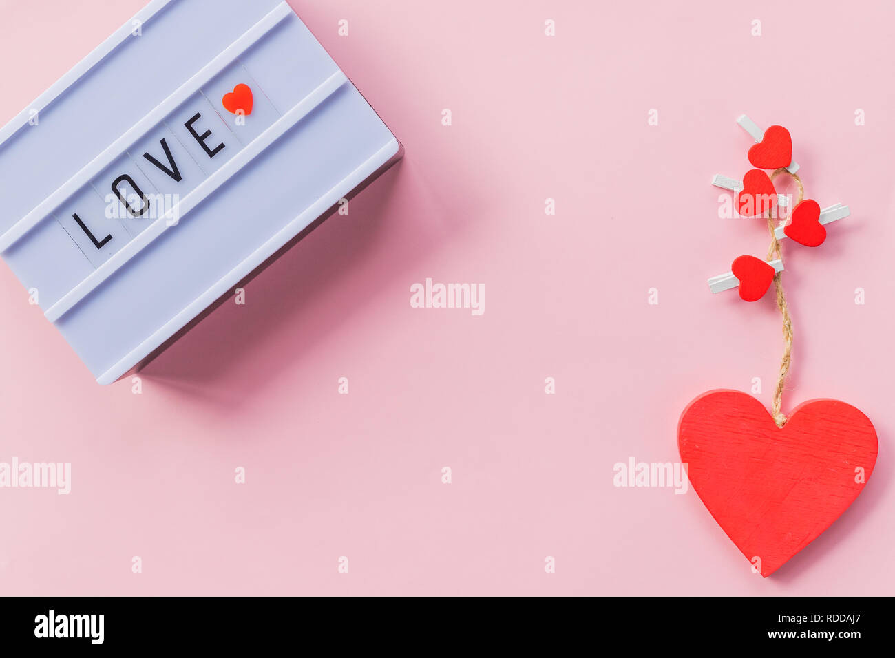Love is a word is written on light box. Love inscription. Decoration for wedding party or Valentine's Day. Love the key to the heart. Love Story. Copy space.Valentine's day interior decoration.February 14 Calendar. - Stock Image