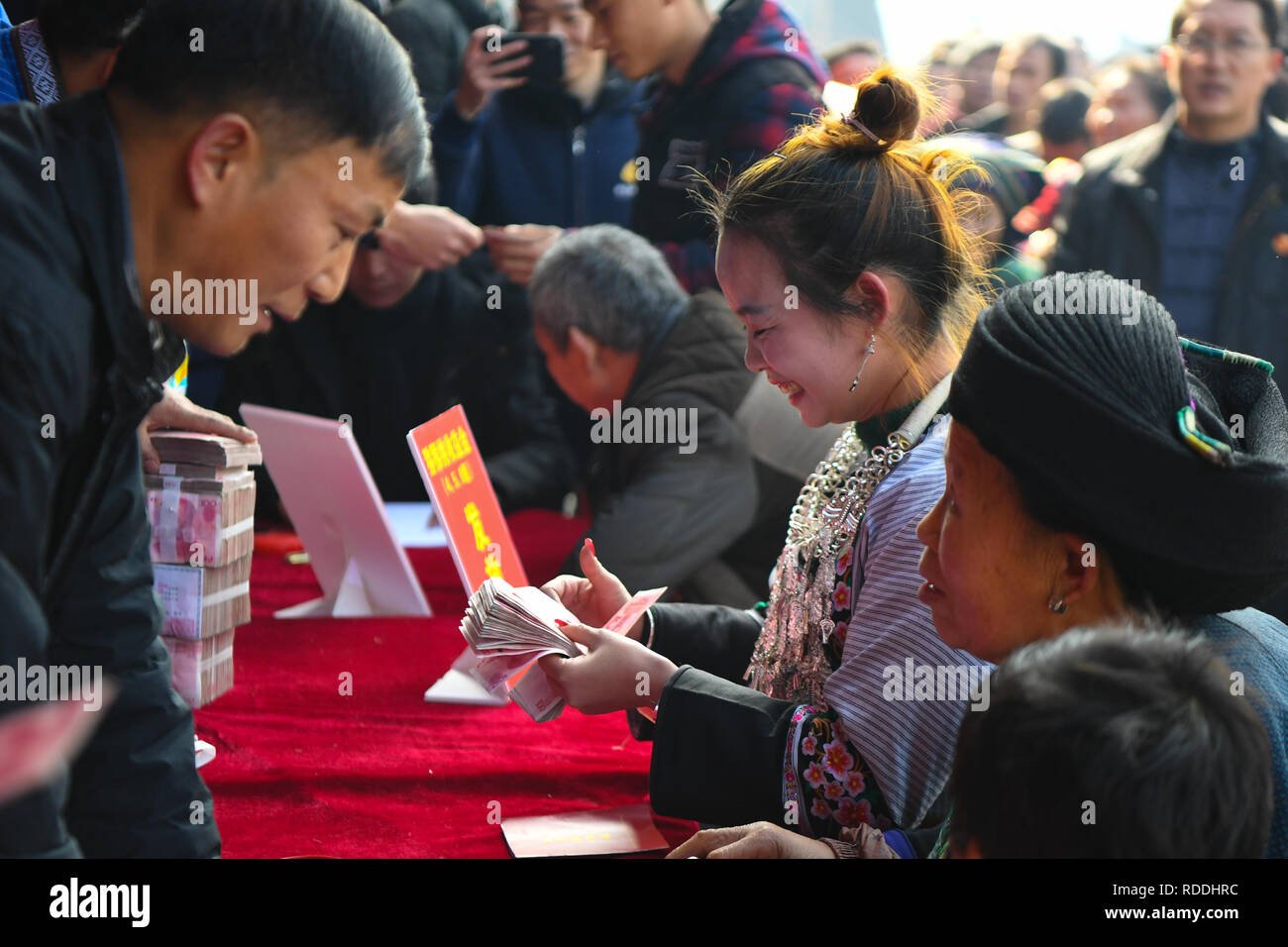 Huayuan, China's Hunan Province. 17th Jan, 2019. A villager counts the money she earned from dividend in Shibadong Village of Huayuan County, central China's Hunan Province, Jan. 17, 2019. Villagers from Shibadong celebrate their traditional New Year in various ways. Credit: Xue Yuge/Xinhua/Alamy Live News - Stock Image
