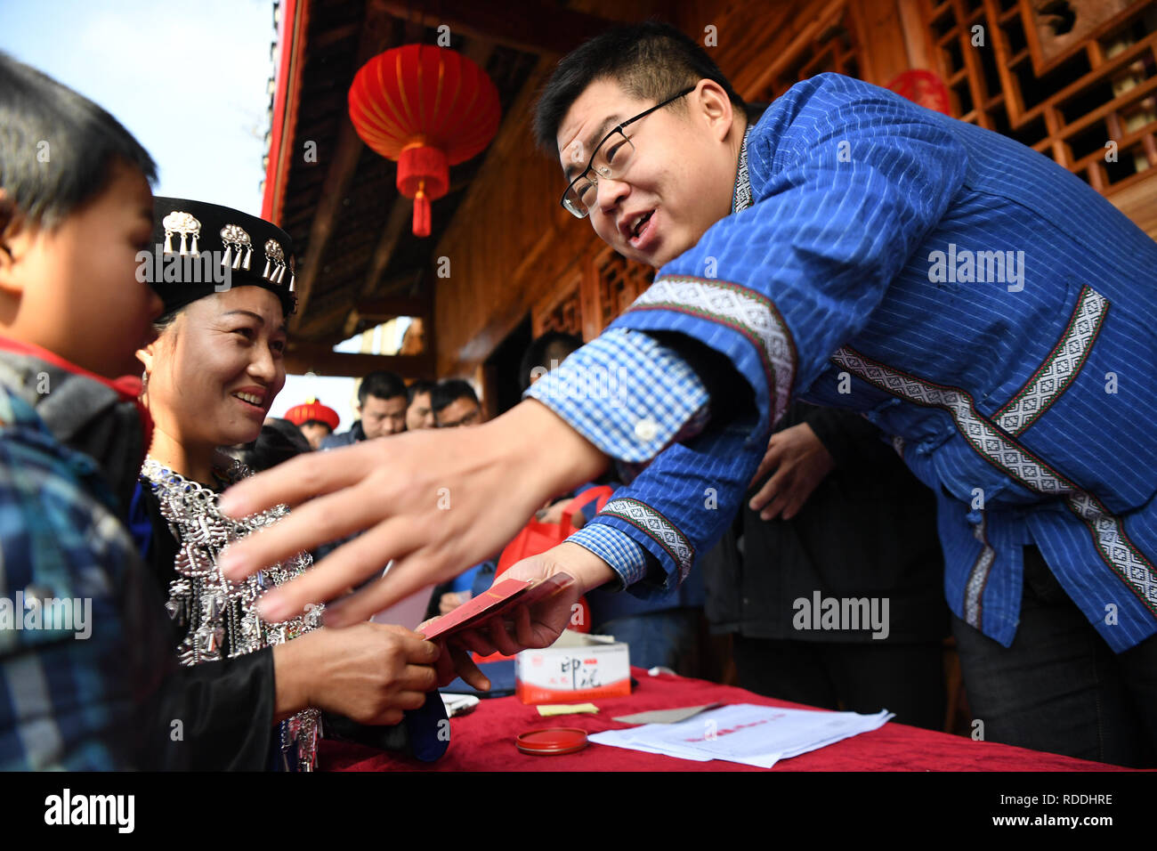 Huayuan, China's Hunan Province. 17th Jan, 2019. A villager receives the money she earned from dividend in Shibadong Village of Huayuan County, central China's Hunan Province, Jan. 17, 2019. Villagers from Shibadong celebrate their traditional New Year in various ways. Credit: Xue Yuge/Xinhua/Alamy Live News - Stock Image
