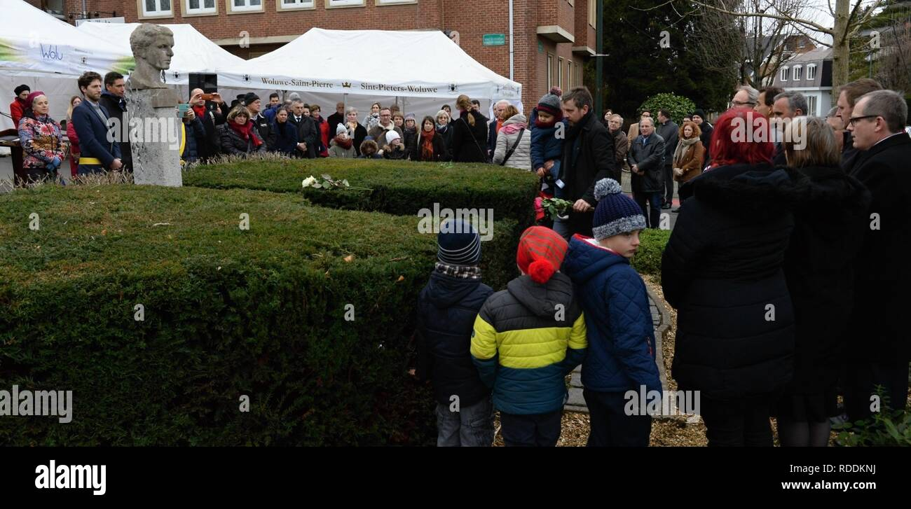 People light candles at the memorial to Jan Palach, who burned himself to death in protest against the occupation of Czechoslovakia by Soviet troops in 1968 marring the Communist reform movement known as Prague Spring, in the Brussels quarter of Sint-Pieters-Woluwe today, on Wednesday, January 16, 2019. Palach's marble bust is placed on a high plinth surrounded by creeping flames. The bust, which was donated by Czech academic sculptor Frantisek Janda to the Czech Embasssy in Belgium, is placed in a villa quarter of diplomats and EU officials. An inscription in French and Flemish reads: Jan Pal - Stock Image