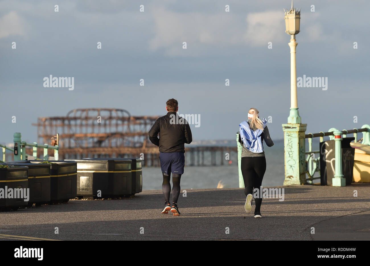 Brighton, UK. 18th Jan, 2019. Runners on a sunny but chilly winter morning along Brighton seafront as the cold weather is forecast to continue throughout Britain over the next few days Credit: Simon Dack/Alamy Live News - Stock Image