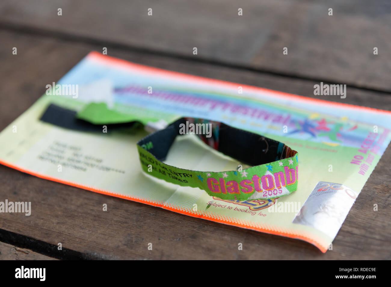 Used Glastonbury ticket and wrist band from Glastonbury Festival 2005. - Stock Image