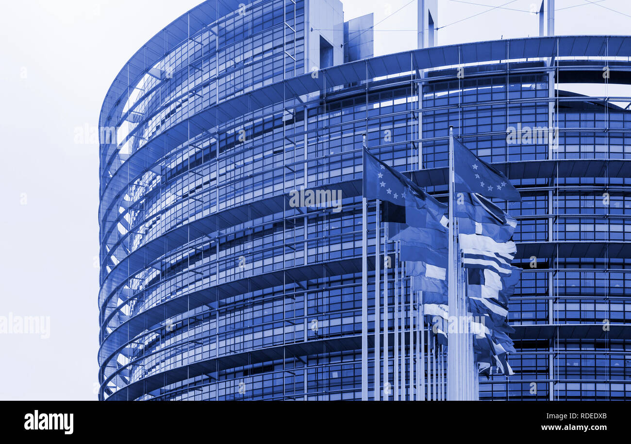 STRASBOURG, FRANCE - MAR 24, 2017: Blue color toned chromacity of official European Union flags - European Parliament building in Strasbourg, France with flags waving  - Stock Image