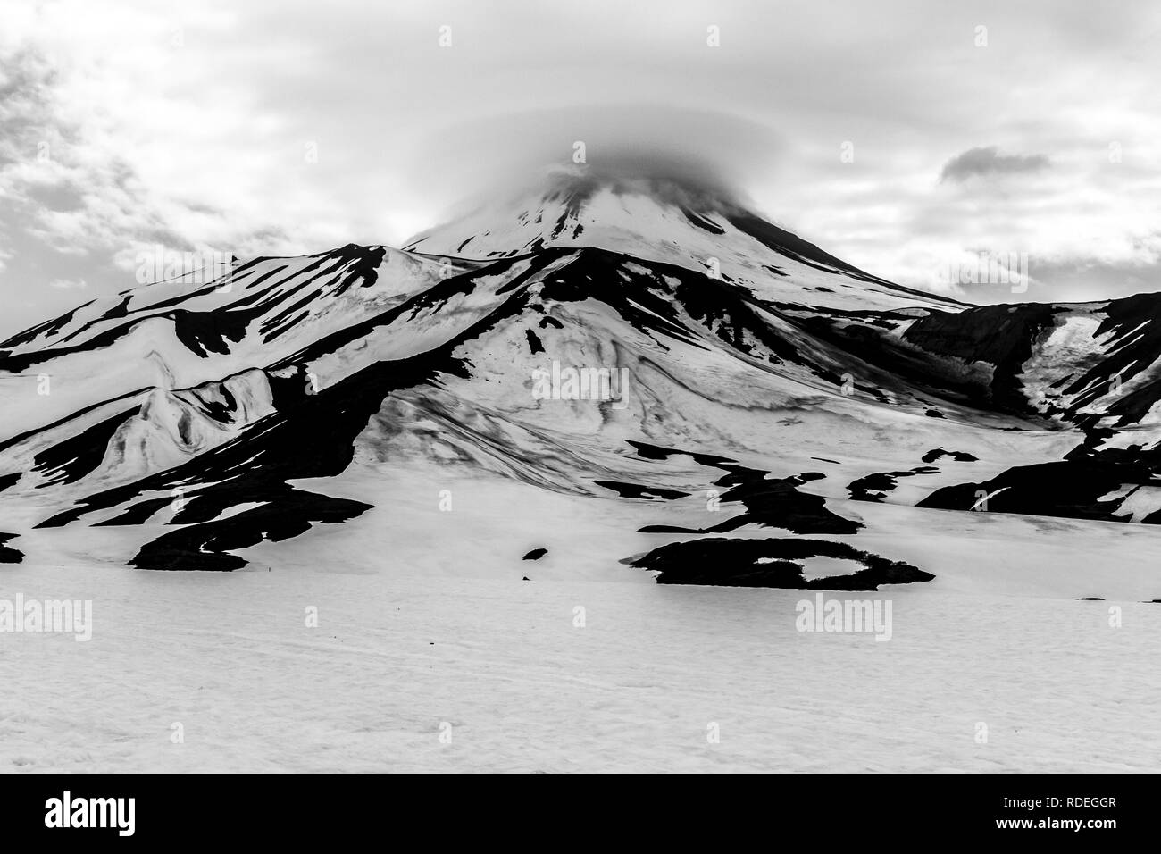 Black and white view of the Avacha Volcano in overcast weather, Kamchatka Peninsula, Russia - Stock Image
