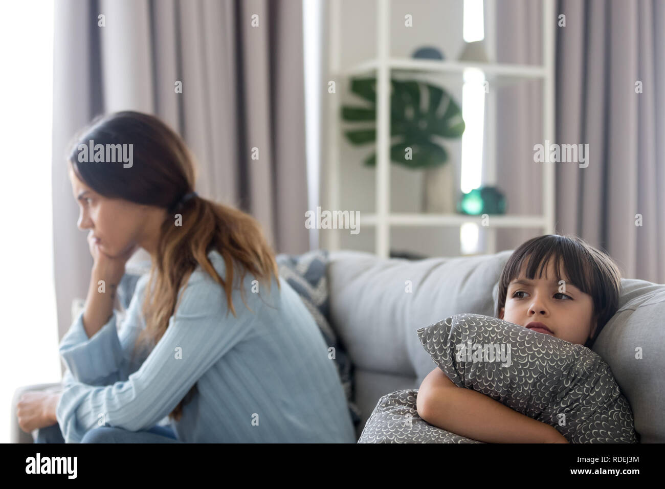 Angry sulky child and annoyed mother not talking after fight - Stock Image
