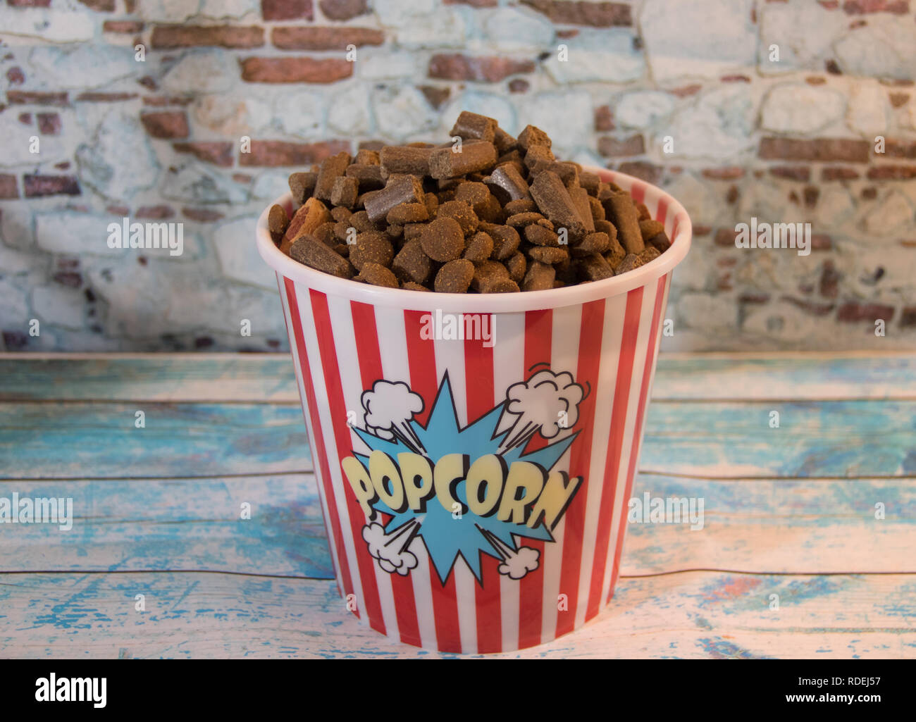 dog prizes in a container of popcorn Stock Photo