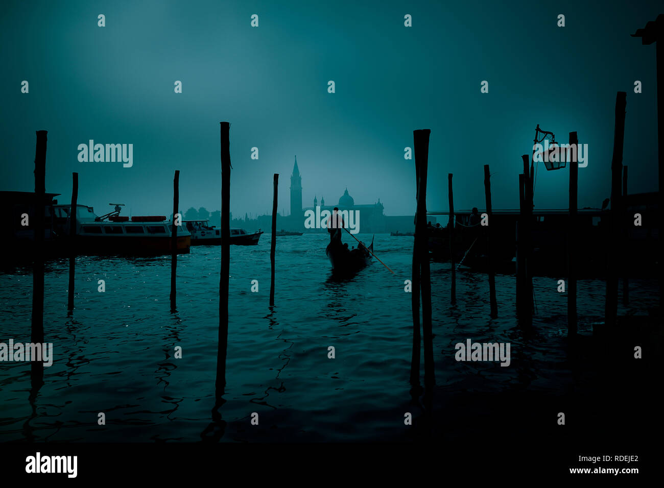 Gondolier in the mystical night - Stock Image