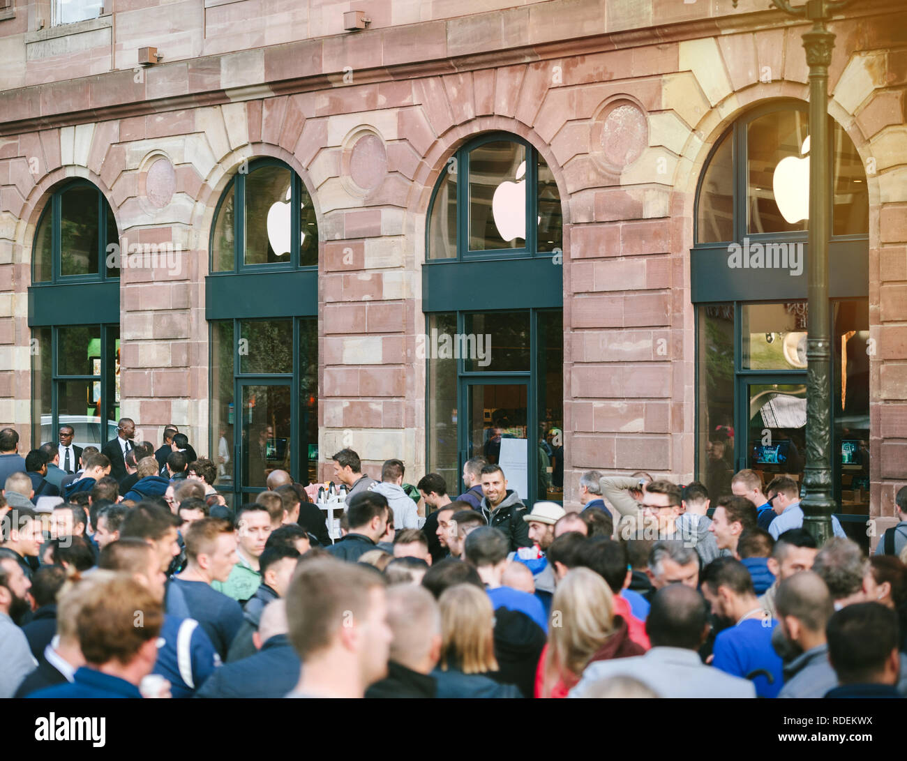 STRASBOURG, FRANCE - SEP, 19 2014: Apple Store with customers waiting in line to buy the latest iPhone iPad Apple Watch and notebook Stock Photo