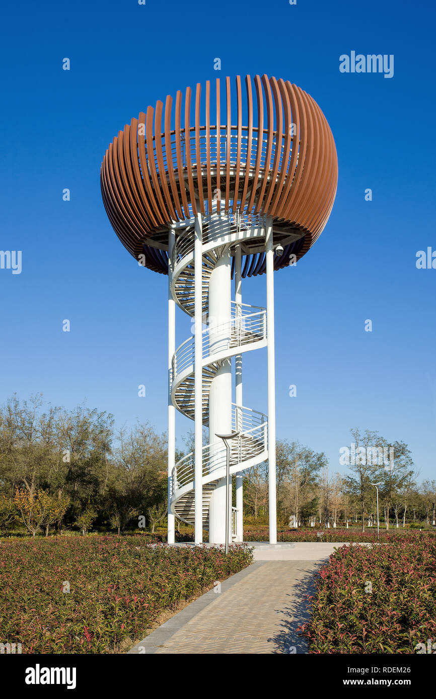 Modern architecture watchtower in a park. Chinese municipal governments want to embrace a new sustainable model of urban planning with green areas. Stock Photo