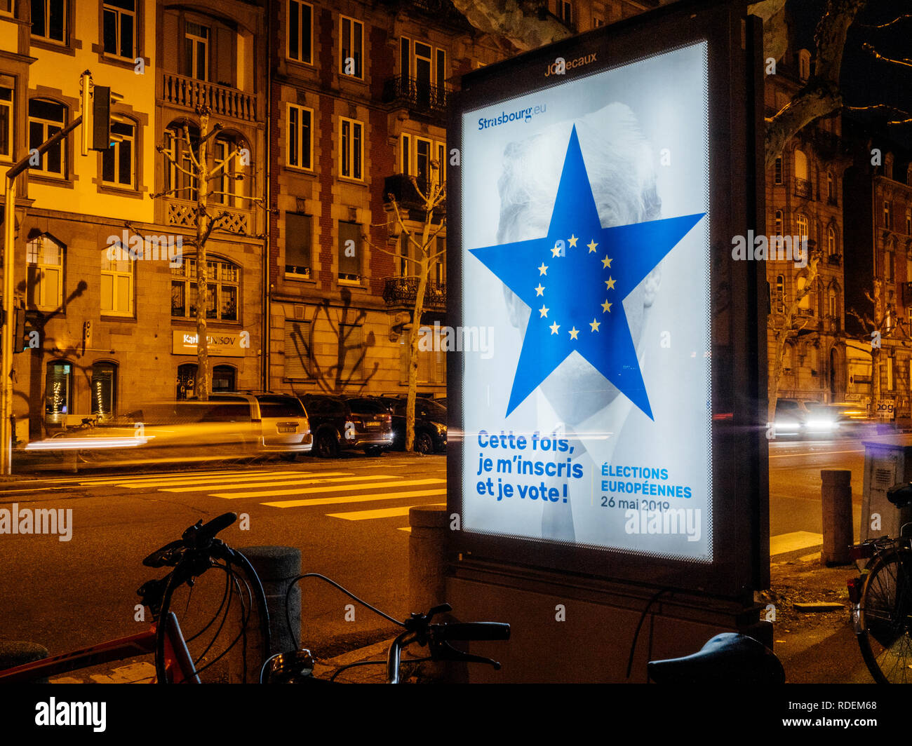 Strasbourg, France - Nov 25, 2018: Bright advertsimg billboard in the night city with ad for the upcoming 2019 European Parliament election to be held in 23 26 May 2019 with Donald Trump allusion - Stock Image