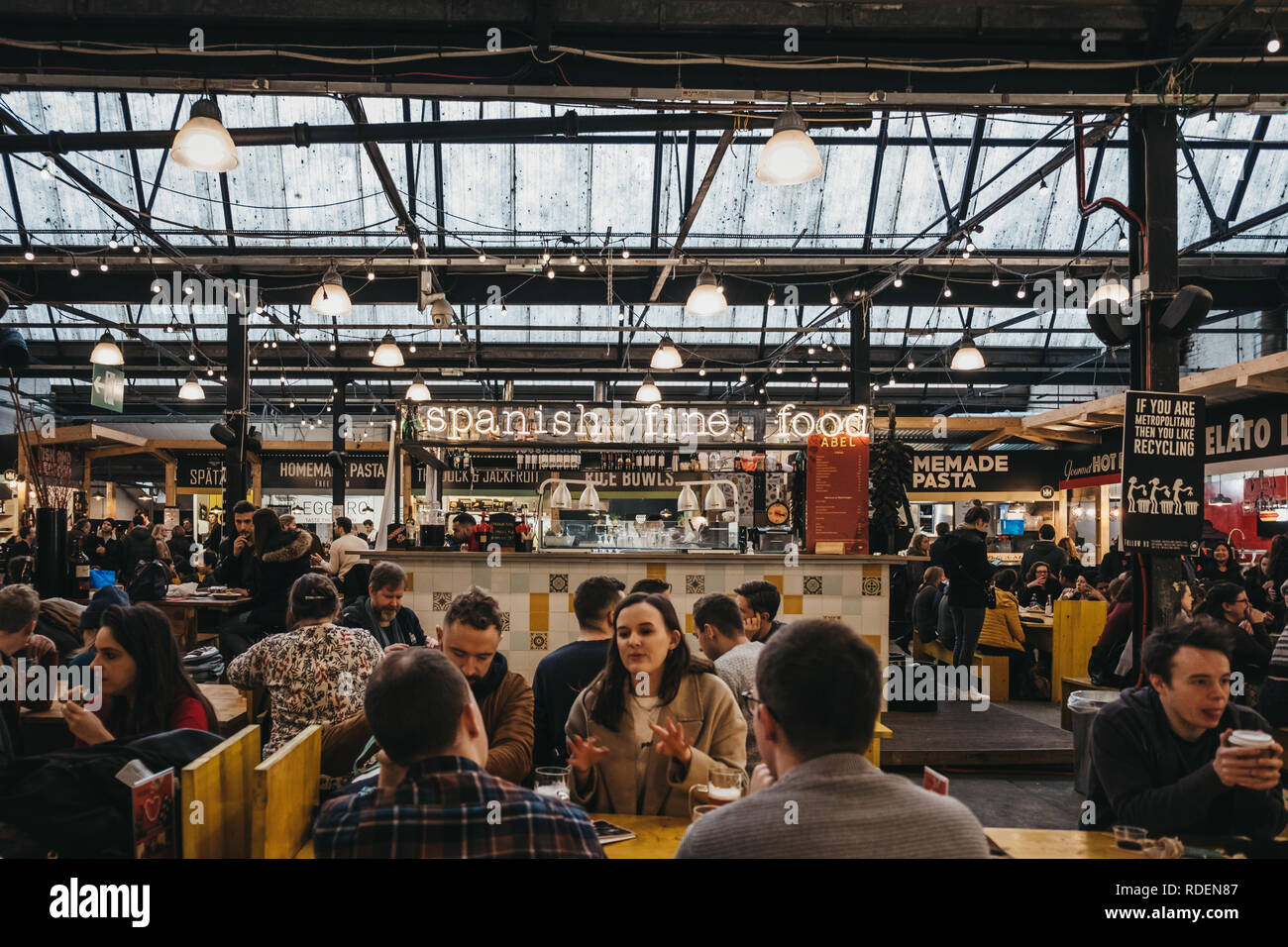 London, UK - January 13, 2019: People at Spanish food stand in Mercato Metropolitano, the first sustainable community market in London focused on revi - Stock Image