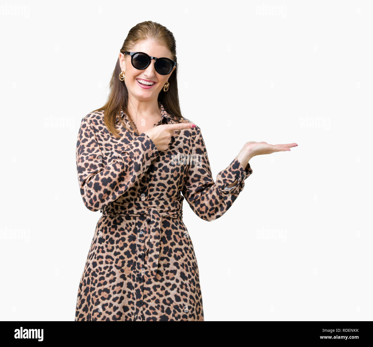 636788c280 Middle age mature rich woman wearing sunglasses and leopard dress over  isolated background amazed and smiling