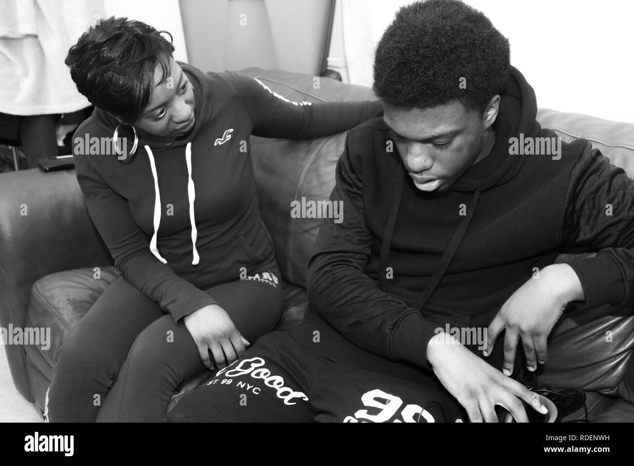 Black mom and teenager son having conversation about love and life - Stock  Image