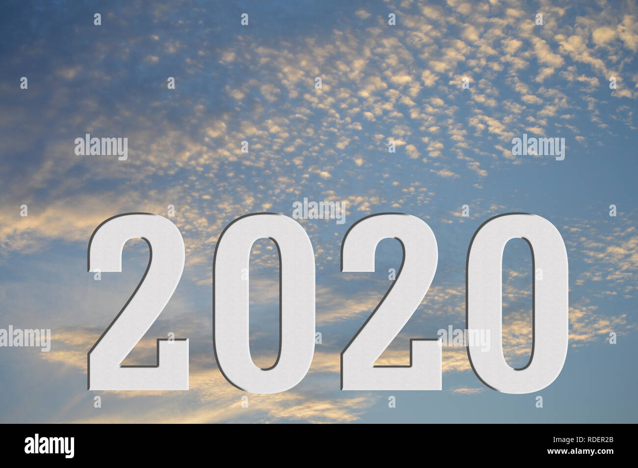 A visual of the year 2020 sitting under a sunset or sunrise, showing the sun has set on 2020 or the sun is rising on 2020 - Stock Image