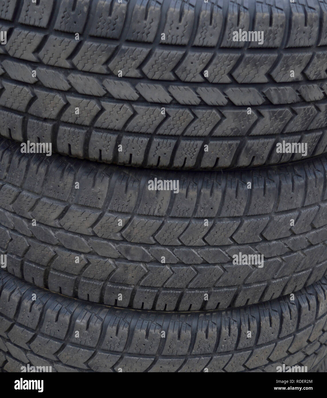 3 tires for a car or truck stacked.  Reminder that tires may need to be change. Stock Photo