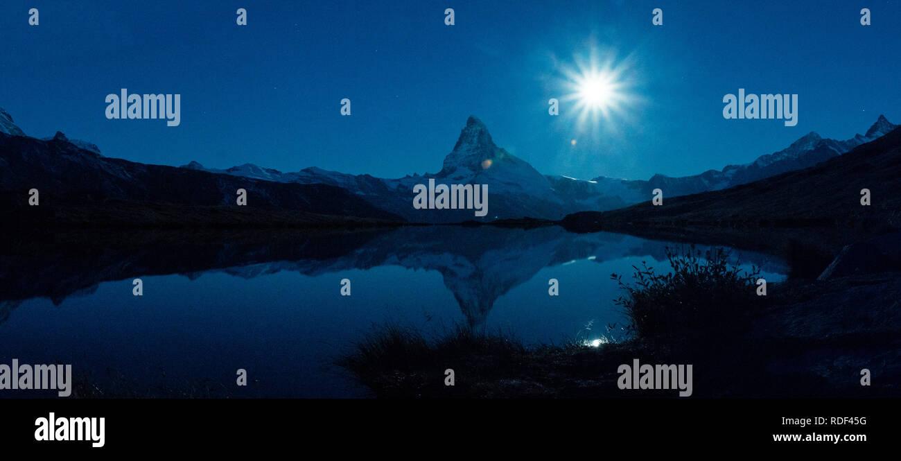 fullmoon over matterhorn and a mountain lake - Stock Image