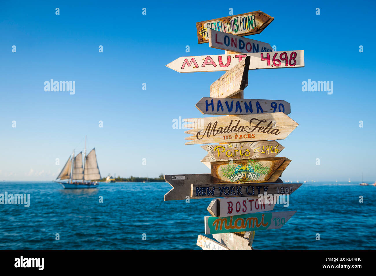 KEY WEST, FLORIDA, USA - JANUARY 13, 2019: A rustic wooden direction sign topped with the message #selfiemostpoint stands on Sunset Pier at Mallory Sq - Stock Image