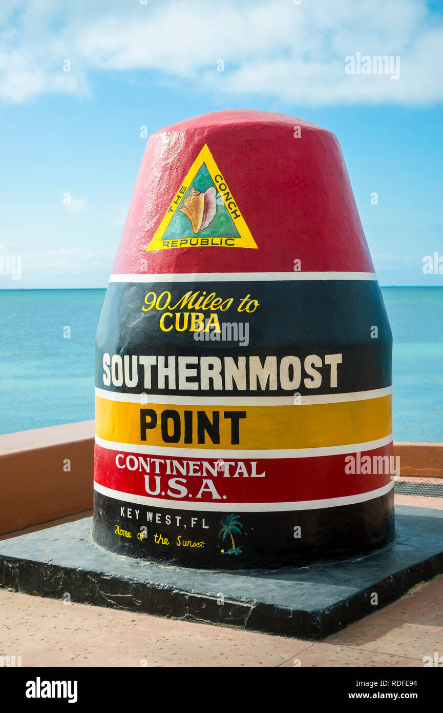 Empty scenic view of the colorful concrete buoy marking the southernmost point of the continental USA in Key West, Florida - Stock Image