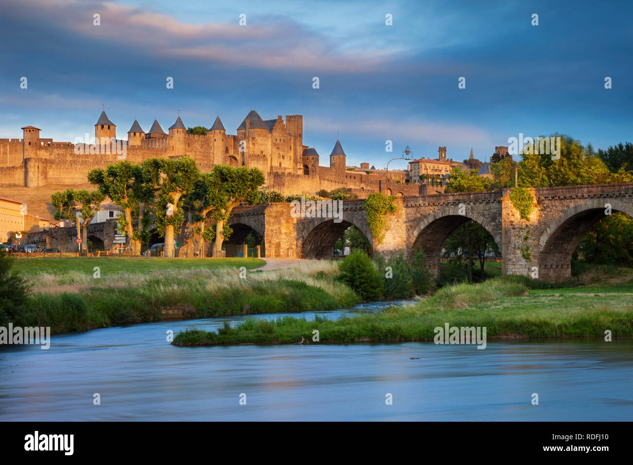 Setting sunlight over medieval town of Carcassonne and River Aude, Occitanie, France - Stock Image