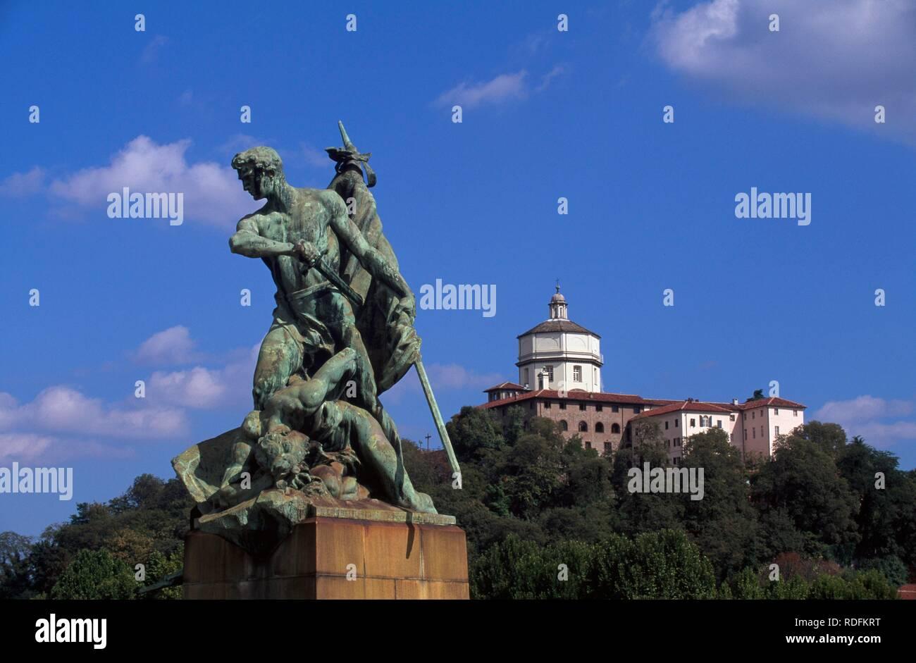 Statue on the bridge Ponte Umberto I and Church of Santa Maria del Monte in Turin, Torino, Piedmont, Italy, Europe - Stock Image