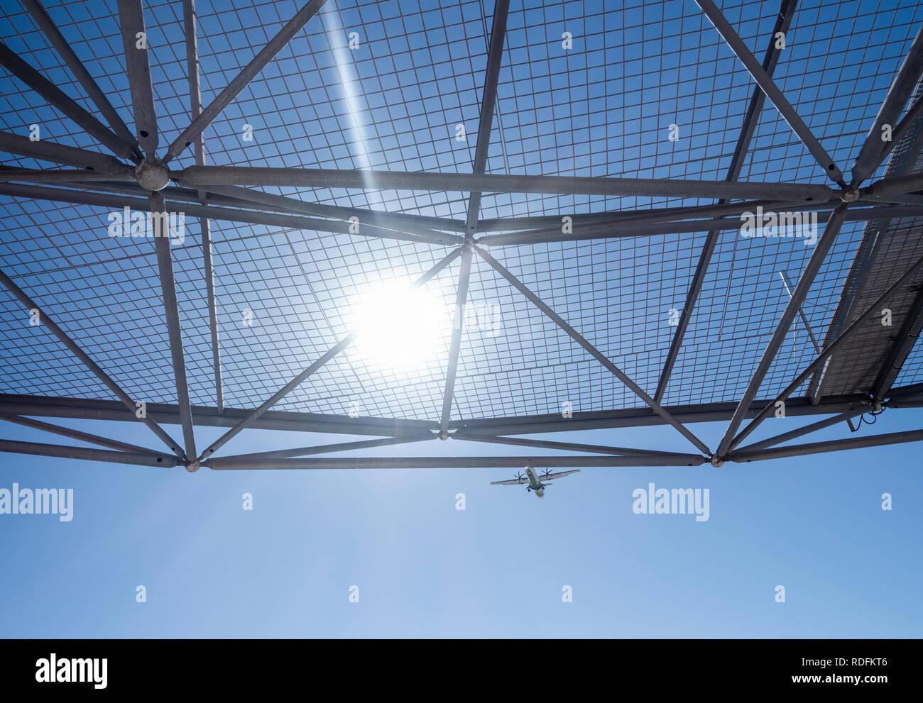 Airplane approaching runway. - Stock Image