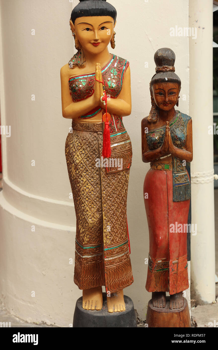 Two handmade statuettes in Chinese tradition, on offer in Chinatown of Singapore as art and craft souvenirs to the many visitors and foreign tourists. - Stock Image