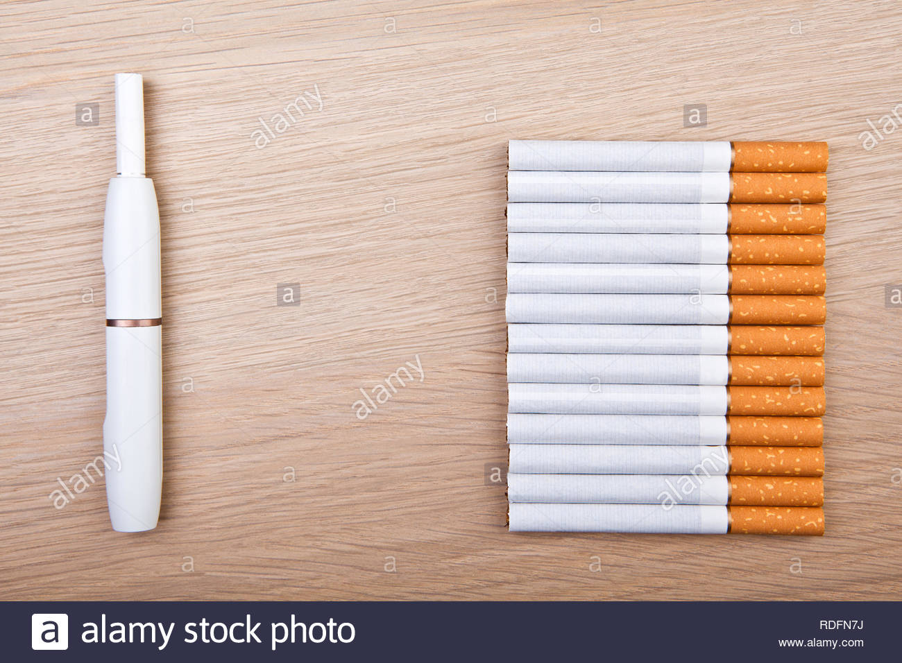 electronic smoke device cigarette wooden table nobody - Stock Image