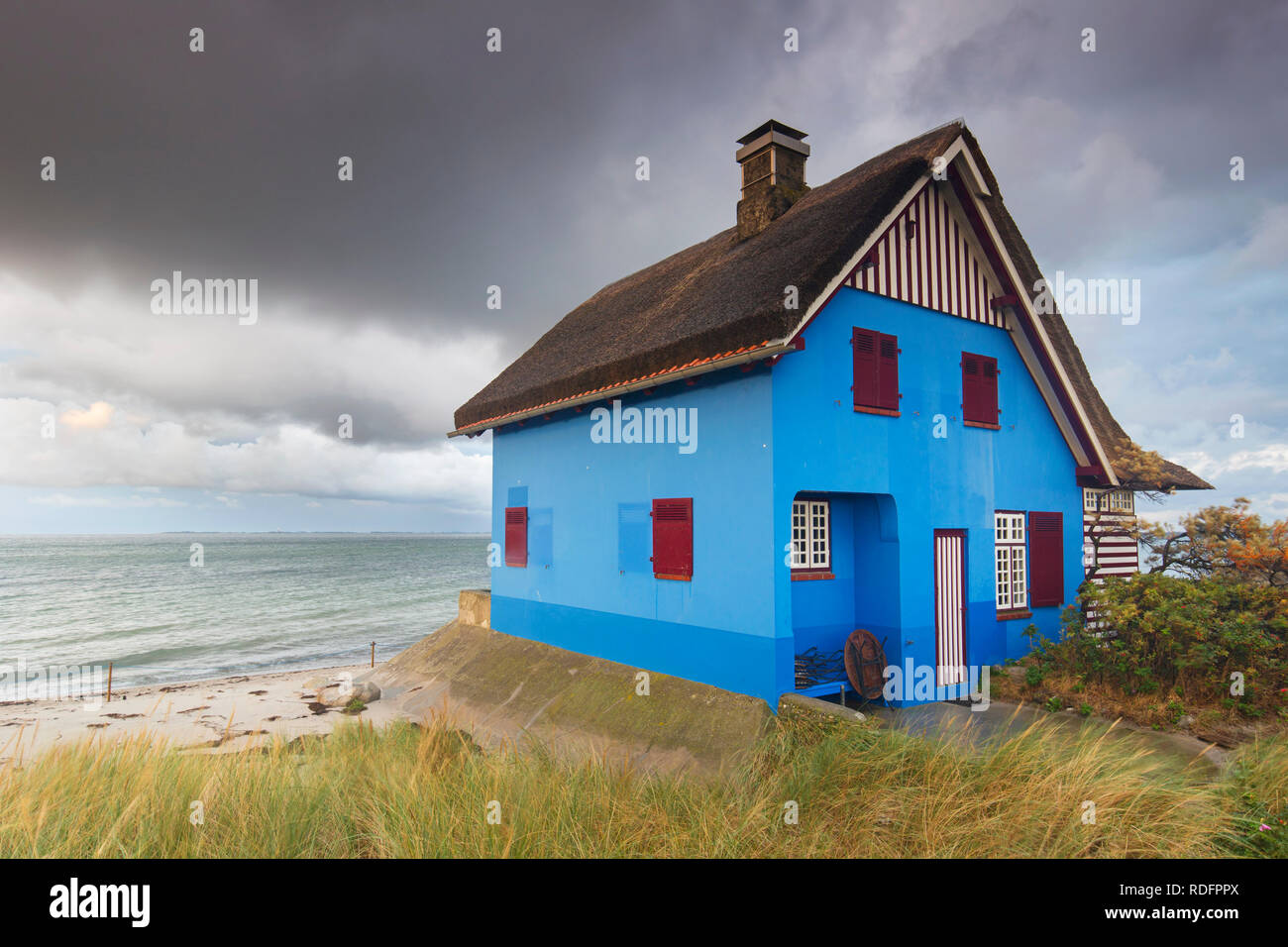 Blue beach house on the peninsula Graswarder, Heiligenhafen, Schleswig-Holstein, Germany Stock Photo