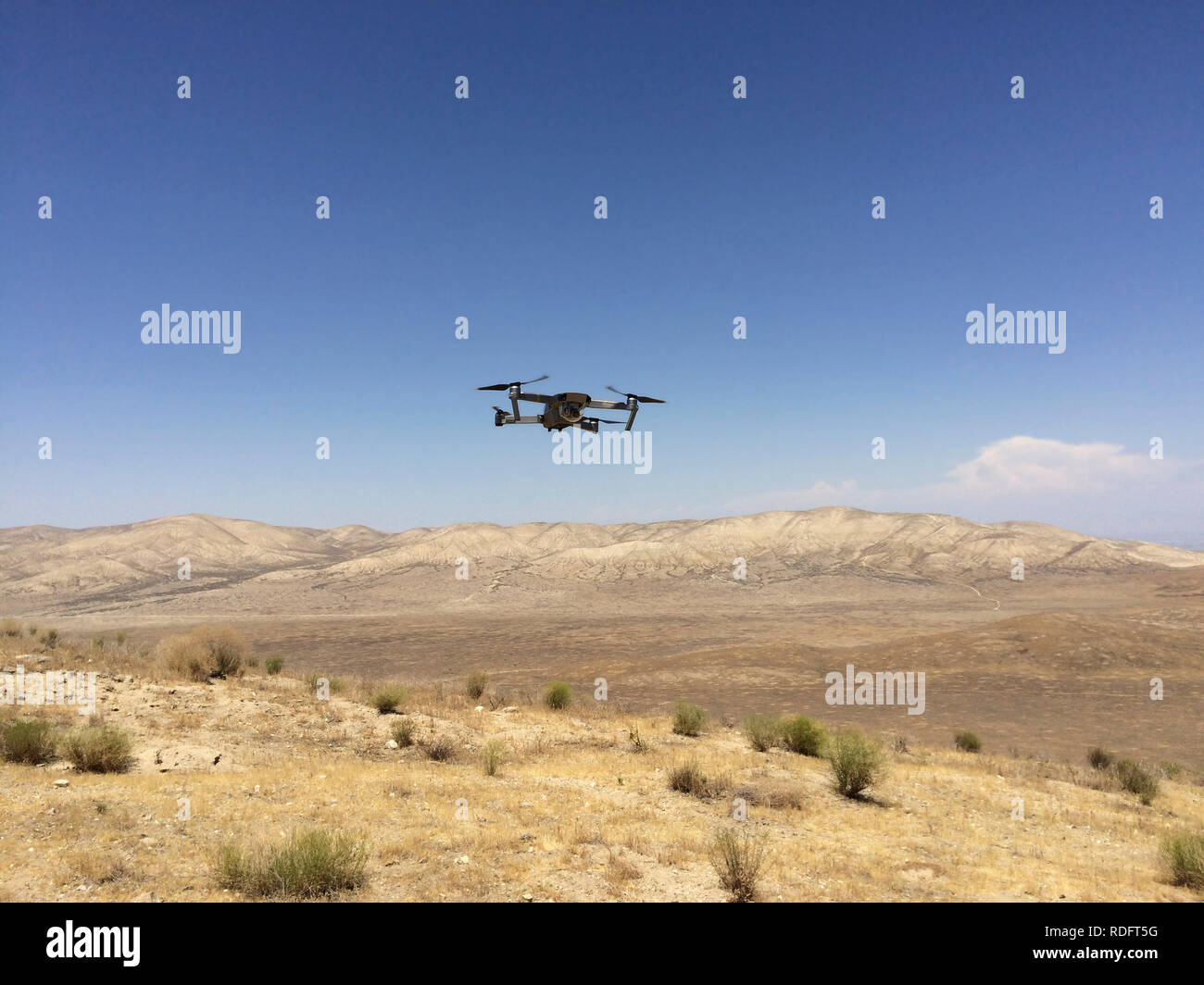 DJI Mavic Pro drone hovering over desert landscape ( camera drone ) - California USA - Stock Image