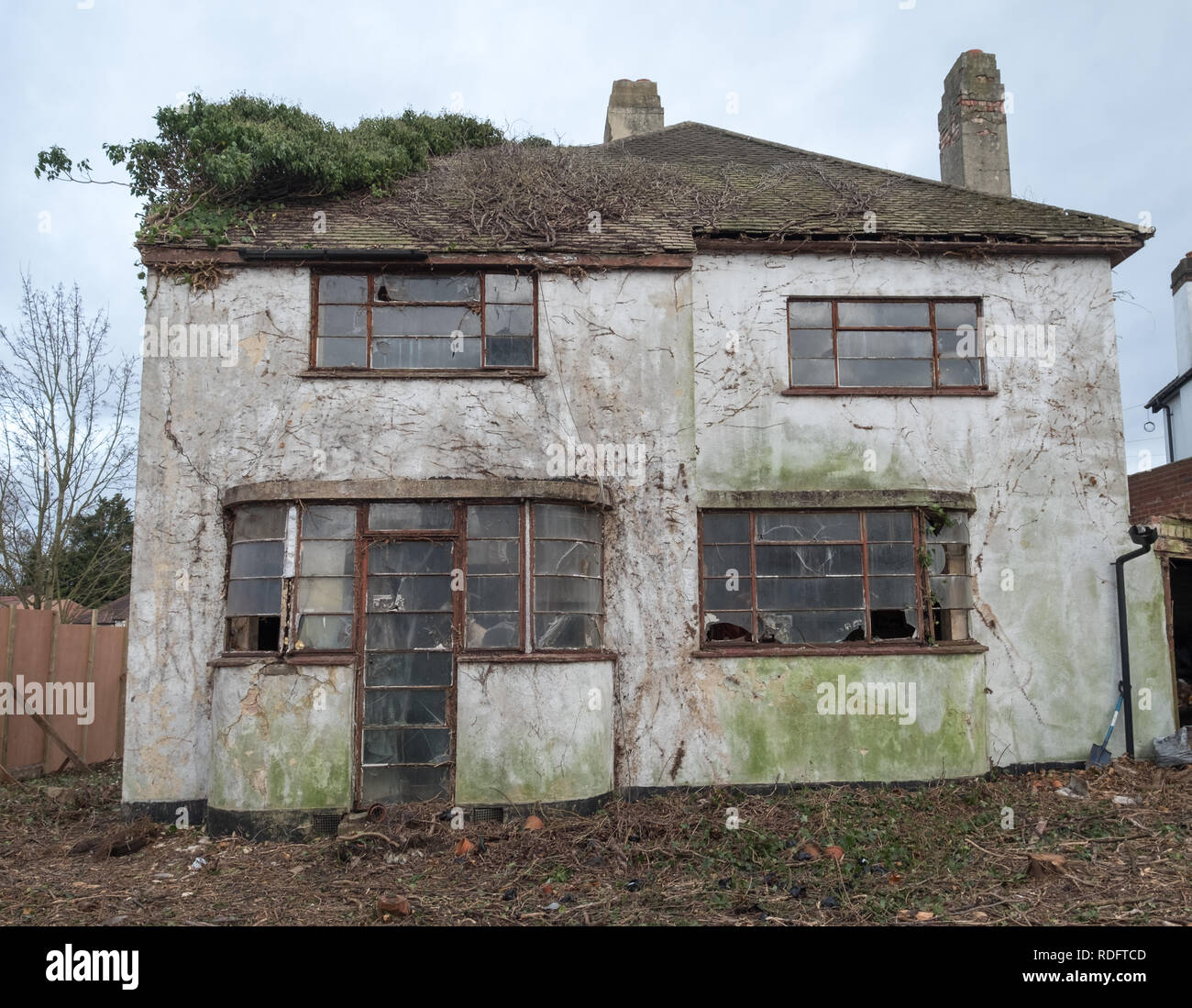 Exterior of derelict house built in 1930's deco style. House is due for demolition. Rayners lane, Harrow Middlesex UK - Stock Image