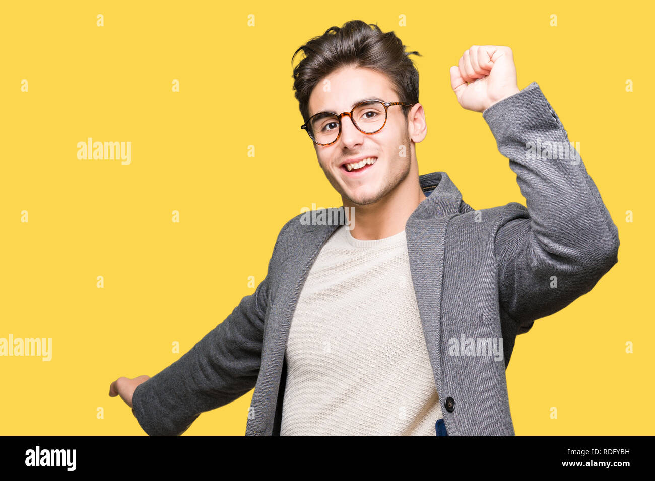4187601abf Young business man wearing glasses over isolated background Dancing happy  and cheerful