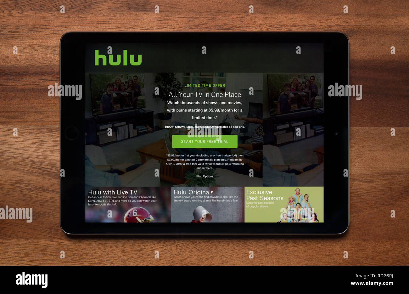 The website of Hulu is seen on an iPad tablet, which is resting on a wooden table (Editorial use only). - Stock Image