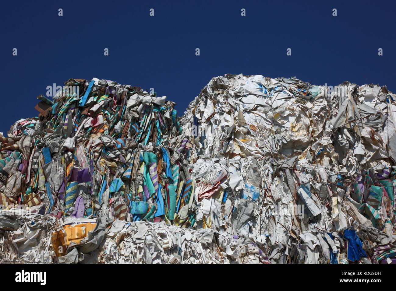 Used paper, stacks of used paper at a recycling yard, paper recycling - Stock Image