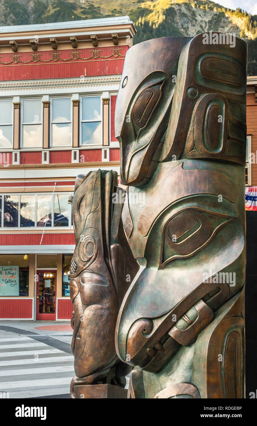 Bronze sculptures by Alaskan Native artists TJ Young (Haida) 'Wasgo' aka a seawolf and of a woman and raven by Stephen Jackson (Tlingit). Juneau, USA. - Stock Image